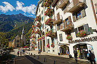 Street view of Hotel De Ville, shops, a church, and the French Alps - Chamonix, France (Horizontal).