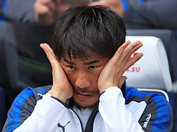 Leicester City's Shinji Okazaki on the substitute's bench during the Premier League match at the John Smith's Stadium, Huddersfield.