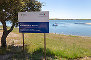 Sign for freshwater beach on reservoir lake at Mourao , Alentejo Central, Evora district, Portugal, southern Europe