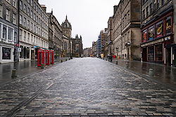 Edinburgh, Scotland, UK. 6 February 2021. The Old town of Edinburgh is almost deserted on a Saturday afternoon during national Covid-19 lockdown. All non essential shops including all tourist souvenir shops are closed as are restaurants and cafes. Pic; The Royal Mile is virtually deserted. Iain Masterton/Alamy Live News