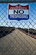 A U.S. Property No Trespassing sign and gate guard the entrance to the Mauna Loa Observatory, Hawaii.