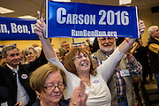 Supporters of Dr. Ben Carson wave banners as he addresses the South Carolina Tea Party Coalition convention on January 18, 2015 in Myrtle Beach, South Carolina. A variety of conservative presidential hopefuls spoke at the gathering on the third day of a three day event.
