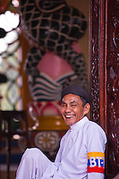Male Worshipper sitting in the Cao Dai Holy See, Tay Ninh.