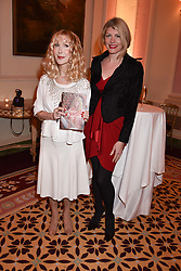 Left to right, Basia Briggs and Meredith Ostrom at a reception to celebrate the publication on 'Mother Anguish' by Basia Briggs held in The Music Room, The Ritz Hotel, 150 Piccadilly, London, England. 04 December 2017.