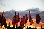 Classic festival banners in the setting sun at Glastonbury Festival 25th July 2016, Somerset, United Kingdom.  The Glastonbury Festival runs over 3 days and has 3000 acts, including music, art and performance and approx. 150.000 attend the anual event.