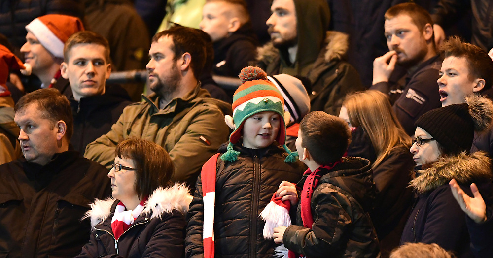 Lincoln City fans watch their team in action<br /> <br /> Photographer Chris Vaughan/CameraSport<br /> <br /> The EFL Sky Bet League Two - Lincoln City v Accrington Stanley - Saturday 16th December 2017 - Sincil Bank - Lincoln<br /> <br /> World Copyright © 2017 CameraSport. All rights reserved. 43 Linden Ave. Countesthorpe. Leicester. England. LE8 5PG - Tel: +44 (0) 116 277 4147 - admin@camerasport.com - www.camerasport.com