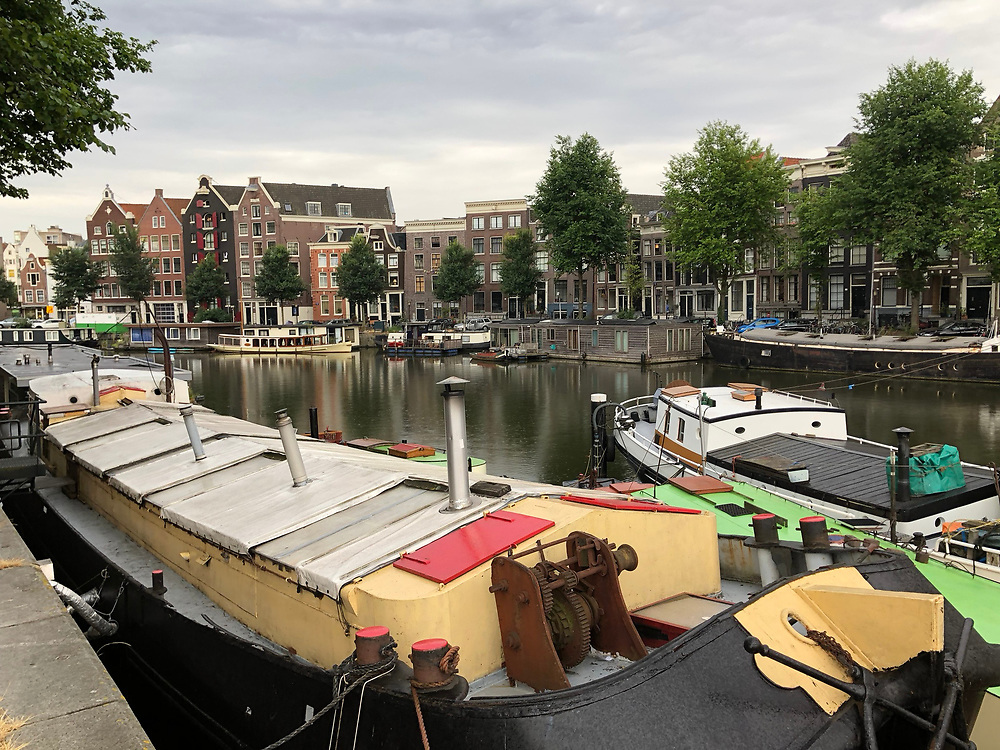 Brightly colored workboat on Amsterdam canal