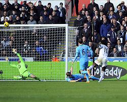Tottenham Hotspur's Hugo Lloris saves Swansea City's Wilfried Bony's shot - Photo mandatory by-line: Joe Meredith/JMP - Tel: Mobile: 07966 386802 19/01/2014 - SPORT - FOOTBALL - Liberty Stadium - Swansea - Swansea City v Tottenham Hotspur - Barclays Premier League