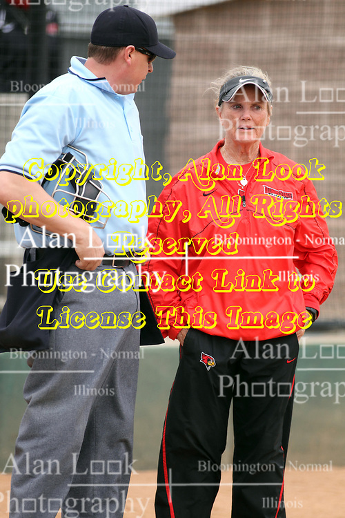06 April 2013:  Coach Melinda Fischer questions a call with home plate umpire Joe Havenhill during an NCAA Division 1 Missouri Valley Conference (MVC) women's softball game between the Drake Bulldogs and the Illinois State Redbirds on Marian Kneer Field in Normal IL