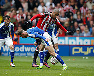 Leon Clarke of Sheffield Utd in a action with Dan Gardner of Chesterfield during the English League One match at  Bramall Lane Stadium, Sheffield. Picture date: April 30th 2017. Pic credit should read: Simon Bellis/Sportimage