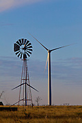 Wind turbines generating electrical power at Horse Hollow Wind Farm, Nolan county, Texas the world's largest wind power project contrast with an old fashion wind turbine driving a water pump.