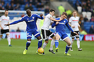 Lucas Piazon of Fulham © is squeezed out by Sol Bamba (l) and Aron Gunnarsson ® of Cardiff city. EFL Skybet championship match, Cardiff city v Fulham at the Cardiff city stadium in Cardiff, South Wales on Saturday 25th February 2017.<br /> pic by Andrew Orchard, Andrew Orchard sports photography.