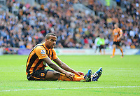 Hull City's Tom Huddlestone sits on the ground after he was fouled by Manchester United's Daley Blind<br /> <br /> Photographer Chris Vaughan/CameraSport<br /> <br /> Football - Barclays Premiership - Hull City v Manchester United - Sunday 24th May 2015 - Kingston Communications Stadium - Hull<br /> <br /> © CameraSport - 43 Linden Ave. Countesthorpe. Leicester. England. LE8 5PG - Tel: +44 (0) 116 277 4147 - admin@camerasport.com - www.camerasport.com