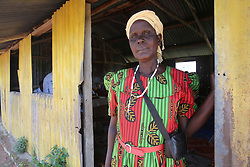 Community Health Volunteer stands outside the ANC outreach clinic SAHFA baseline survey visit to Angiya, Homa Bay County, Kenya.  SAHFA Kenya © April 2019
