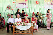 A Kayah ethnic minority couple on their wedding day on 22nd March 2016 in Kayah state, Myanmar. In the past most people residing in Kayah State were traditional spirit worshippers, but significant numbers have converted to Christianity, especially  Baptists or Catholics