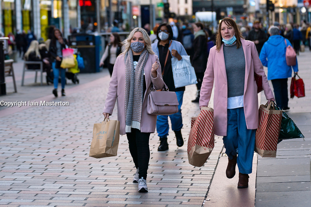 Glasgow, Scotland, UK. 19 November 2020. On the day before the highest level 4 lockdown is imposed on west and central Scotland, shops in Glasgow city centre and streets are busy with members of the public. Pictured; Women shopping on Argyle Street.  Iain Masterton/Alamy Live News