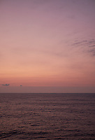 Pastel colored sky and clouds over the Pacific Ocean at dawn.  Image 11 of 21  for a panorama taken with a Fuji X-T1 camera and 35 mm f/1.4 lens  (ISO 400, 35 mm, f/2.8, 1/30 sec). Raw images processed with Capture One Pro and stitched together with AutoPano Giga Pro.