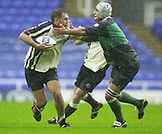 Reading, Berkshire, UK., Exiles centre, Jason Wright, hands off the challenge from the L'Aquilq flanker., Parker Pen Shield 07.10.2001,<br /> London Irish v L'Aquila (Italy): [Mandatory Credit; Peter Spurrier:Intersport Images]