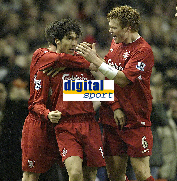 Photo: Aidan Ellis.<br /> Liverpool v Arsenal. The Barclays Premiership. 14/02/2006.<br /> Liverpool's John Arne Riise congratulates goal scorer Luis Garcia
