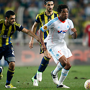 Fenerbahce's Bekir irtegun (L) and Marseille's Loic Remy (R) during their UEFA Europa League Group Stage Group C soccer match Fenerbahce between Marseille at Sukru Saracaoglu stadium in Istanbul Turkey on Thursday 20 September 2012. Photo by TURKPIX