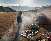 """Morning breakfast. Cooking on dung fire. Life in our camp below the Aqbelis Pass, in the Little Pamir range. Guiding and photographing Paul Salopek while trekking with 2 donkeys across the """"Roof of the World"""", through the Afghan Pamir and Hindukush mountains, into Pakistan and the Karakoram mountains of the Greater Western Himalaya."""