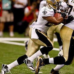 August 21, 2010; New Orleans, LA, USA; New Orleans Saints running back Reggie Bush (25) follows his blocks for a touchdown during the first quarter of a preseason game at the Louisiana Superdome. Mandatory Credit: Derick E. Hingle