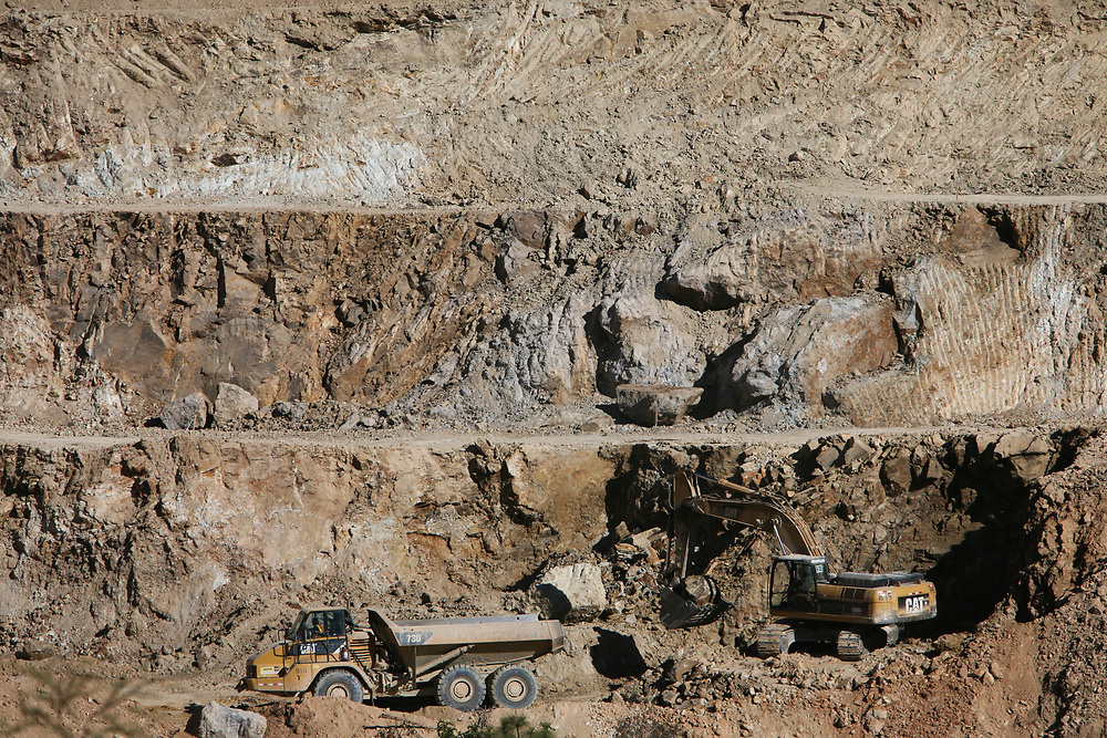 Excavating machinery in the main pit at the Marlin gold mine, Sipacapa and San Miguel Ixtahuacán, San Marcos, Guatemala. The gold is cyanide-leached. The mine is owned by Montana, a subsidiary of Canadian company, Goldcorp.