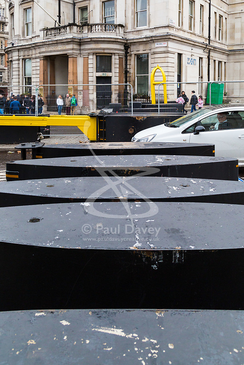 London, December 31 2017. Police in high visibility jackets and numerous anti-terrorism and crowd control measures are in place in the capital ahead of the New Year's Eve fireworks and revelry in central London. PICTURED: Heavy barriers have been placed where the Mall meets Trafalgar Square. © SWNS