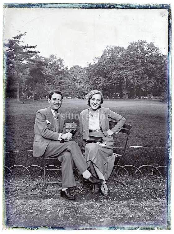 couple casual posing in public park 1930s France