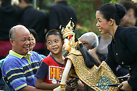 Thai family enjoying a puppet show. Thai puppetry, known as hun lakhon lek, is an ancient art form similar to buruku. The shows are usually accompanied by music and narration who tells the story derived from the Ramakien, the Thai version of the Ramayana.