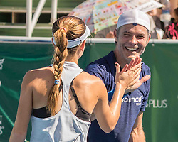 November 5, 2017 - Delray Beach, Florida, US - Actor TIMOTHY OLYPHANT hi-fives his doubles partner CI CI BELLIS at the Delray Beach Stadium and Tennis Center in Florida during the 2017 Chris Evert/ Raymond James Pro-Celebrity Tennis Classic. Chris Evert Charities has raised more than $23 million in an ongoing campaign for Florida's most at-risk children. (Credit Image: © Arnold Drapkin via ZUMA Wire)