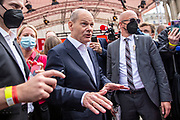 SPD Chancellor candidate and current German Finance Minister Olaf Scholz speaks to supporters following an election campaign event of the German Social Democratic Party (SPD) at Bebelplatz square In Berlin, Germany, August 27, 2021. Germany's federal elections are due to take place on September 26, 2021.