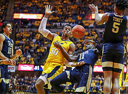Dec 8, 2018; Morgantown, WV, USA; West Virginia Mountaineers forward Sagaba Konate (50) and Pittsburgh Panthers guard Sidy N'Dir (11) fight for a loose ball during the second half at WVU Coliseum. Mandatory Credit: Ben Queen-USA TODAY Sports