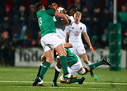 Joel Kpoku of England U20 is tackled by Charlie Ryan and Thomas Clarkson of Ireland U20 - Mandatory by-line: Ken Sutton/JMP - 01/02/2019 - RUGBY - Irish Independent Park - Cork, Cork - Ireland U20 v England U20 -