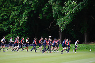 Picture by Andrew Tobin/Tobinators Ltd +44 7710 761829.24/05/2013.The England squad warm up during the England training session at Pennyhill Park, Bagshot ahead of the match against the Barbarians on 26th May 2013.