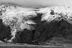 Volcanic eruption, Eyjafjallajokull, Iceland.  The canyon shows where the flood came out from the melting ice