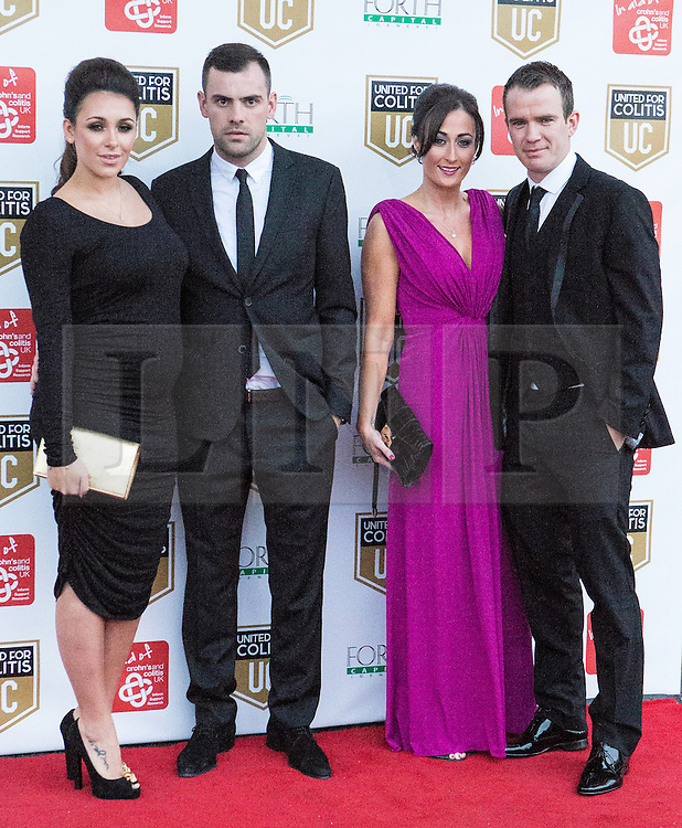 © Licensed to London News Pictures . 27/03/2014 . Manchester , UK . Darren Gibson (2nd left) arrives at a gala dinner at Manchester United Football Club in support of United for Colitis , in aid of Crohn's And Colitis UK . Photo credit : LNP