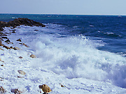 Sea waves licking the rocks. Photographed in Jaffa