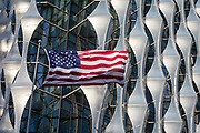 The Stars and Stripes flies over the US Embassy at Nine Elms in south London, on 16th January 2018, in London, England. On the day when the consulate opened for public business (visa applications etc.), after its controversial move from Grosvenor Square in central London to the south bank.