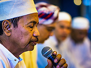 14 JUNE 2017 - BANGKOK, THAILAND: A man leads a prayer before Iftar at Masjid Hidayatun Islam. Iftar is the evening meal when Muslims end their daily Ramadan fast at sunset. Iftar is a communal event at Masjid Hidayatun Islam and more than a hundred people usually attend the meal.      PHOTO BY JACK KURTZ