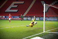 Goal. Charlton's Goalkeeper Ben Amos is  beaten by Rochdale's Stephen Humphrys shot during the EFL Sky Bet League 1 match between Charlton Athletic and Rochdale at The Valley, London, England on 12 January 2021.