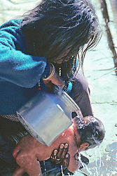Woman Washing Newborn
