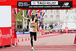 © Licensed to London News Pictures. 28/04/2019. London, UK.  Kenya's Eliud Kipchoge crosses the finish line and wins the men's race at the London Marathon 2019. Photo credit: Dinendra Haria/LNP