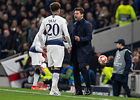 Football - 2018 / 2019 UEFA Champions League - Quarter Final , First Leg: Tottenham Hotspur vs. Manchester City<br /> <br /> Mauricio Pochettino, Manager of Tottenham FC, has some early words with Dele Alli (Tottenham FC) at White Hart Lane Stadium.<br /> <br /> COLORSPORT/DANIEL BEARHAM