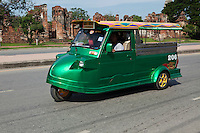 """Ayutthaya Style Tuk-Tuk - The vehicles known as Tuk-Tuks originated in Japan by Daihatsu.  They were then  produced in Thailand years later evolving as a motorized relative of the rickshaw. The Tuk-Tuk was given its name from the sound of the early models with single stroke motors powering the first three-wheelers.  They had a distinctive sound when operating, and the """"tuk-tuk"""" sound became a familiar to many in need of convenient transportation in Bangkok. The technology and quality have improved over the years, while emerging as one of Thailand's most recognizable and identifiable symbols. Ayuthaya style Tuk-Tuks are built by hand, with a special and distinctive style slightly different than its Bangkok cousins."""