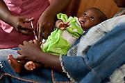 A child received pentavalent vaccine at the Kaniya PHU in the village of Kaniya, Sierra Leone, on Friday April 23, 2010..