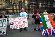 A man holds the national flag of India over the Union Jack next to  Pro leave supporters on the day after Parliament voted to take control of Parliamentary proceedings and prior to a vote on a bill to prevent the UK leaving the EU without a deal at the end of October, on 5th September 2019 in London, United Kingdom. Prime Minister Boris Johnson has insisted Britain will leave the European Union on October 31 2019, despite a defeat in the House of Commons at the hands of MPs from across political partys.