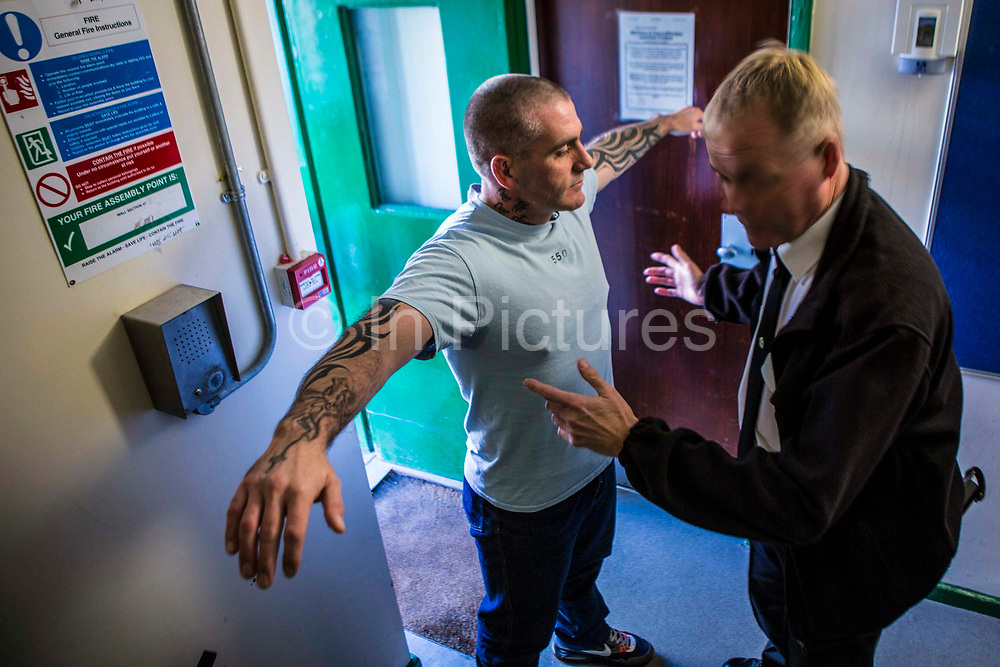 A prisoner gets a body search before entering the visits hall. HMP/YOI Portland, Dorset, United Kingdom.