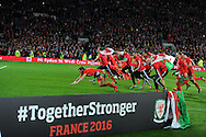 Gareth Bale (l) of Wales leads the celebrations after the match as the team qualify for Euro 2016 finals.  Wales v Andorra, Euro 2016 qualifying match at the Cardiff city stadium  in Cardiff, South Wales  on Tuesday 13th October 2015. <br /> pic by  Andrew Orchard, Andrew Orchard sports photography.