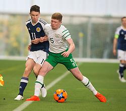 Scotland's Anthony McDonald and Repulic of Ireland's Kameron Ledwidge. half time : Scotland 0 v 0 Repulic of Ireland, Under 16 Victory Shield played at Oriam, Edinburgh.